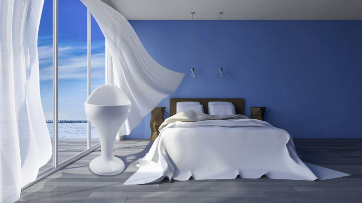 3ds rendered image of bed in seaside room which have blue color cracked concrete wall  in day time, White fabric curtains being blown by wind from the sea